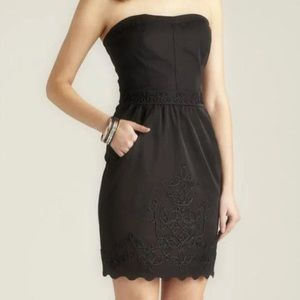 Black strapless embroidered dress with pockets